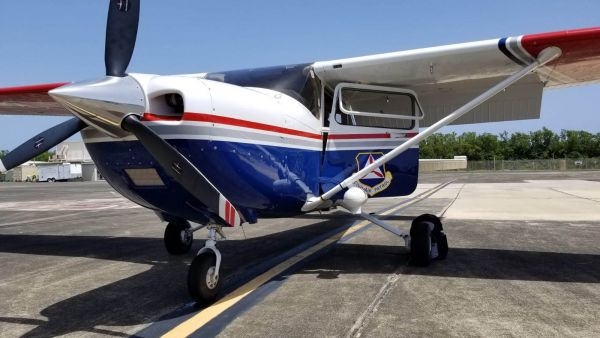 Civil Air Patrol aircraft fitted with XCAM aerial survey pod. These aircraft were mobilised to do daily missions to the south of the island to record systematic aerial photography in the unique XCAM circular pattern.