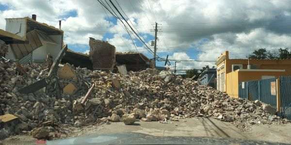 Collapsed building in Guayanilla. Guayanilla was one of the small towns that suffered the most damage. The side of this building collapsed and spilled onto the road.