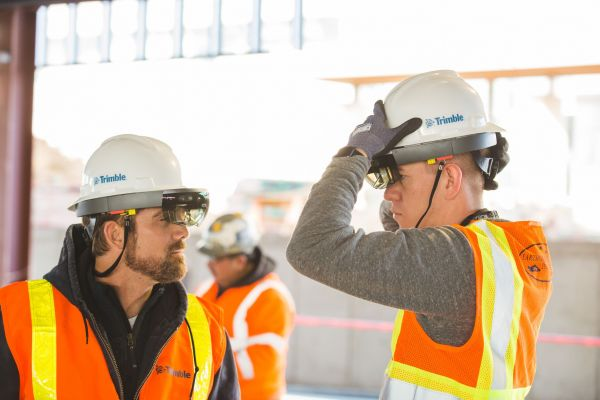 Construction professionals try a new hard hat solution for Microsoft HoloLens on site.